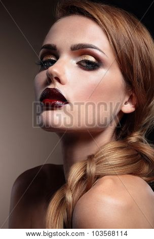 Beautiful Woman With Stylish Make-up, Vinous Lips . Beauty Face. Picture Taken In The Studio On A Br