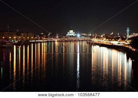 Krymsky Bridge (or Crimean Bridge) Across Moskva River With Background Cathedral Of Jesus Christ The