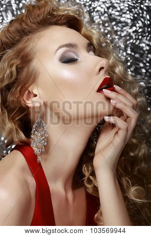 Profile Of Sensual Woman Over Silver Background