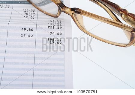 Close Up Of Glasses And Figures