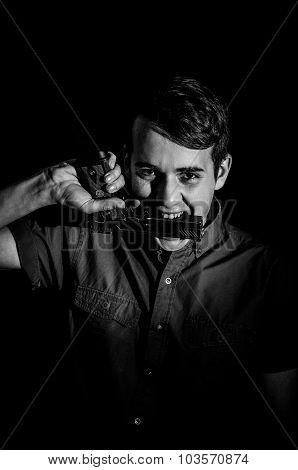 Crazy Young Man With A Gun