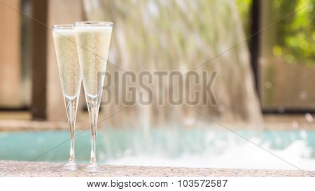 Two Glasses Of Champagne Near Outdoor Jacuzzi