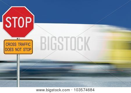 Red Stop Road Sign, Motion Blurred Truck Vehicle Traffic In Background, Regulatory Warning Signage