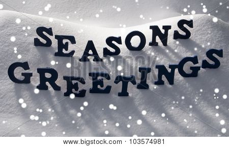 Blue Word Seasons Greetings On Snow, Snowflakes