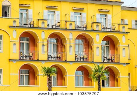 Windows decorated with flowers in italy.
