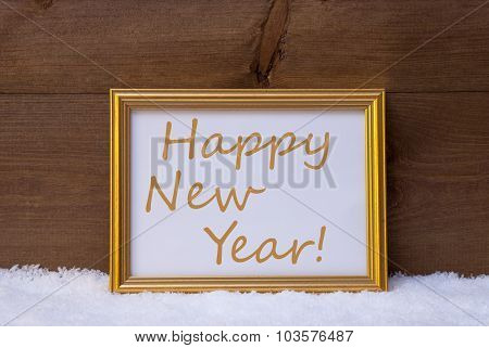 Golden Frame With Text Happy New Year On Snow