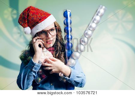 Funny hipster girl in Christmas hat making phone call