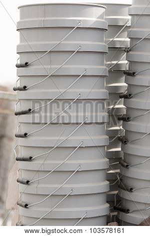 Stacks Of Gray Buckets