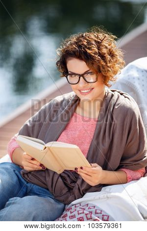 Pleasant girl reading book