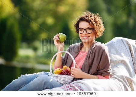 Nice girl holding fruits