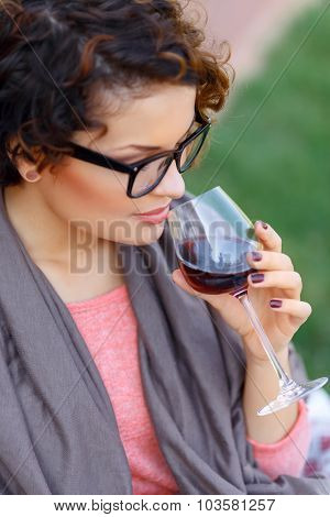 Pleasant girl drinking wine