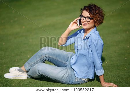 Pleasant girl resting on the grass