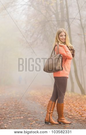 Happy Fashion Woman With Handbag In Autumn Park