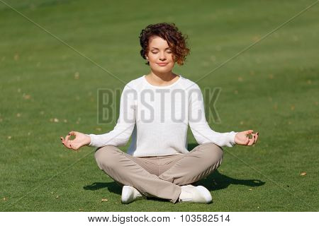 Pleasant girl practicing yoga