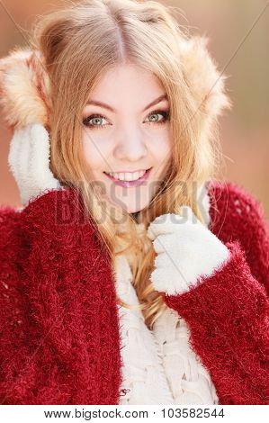 Portrait Of Pretty Smiling Woman In Earmuffs.