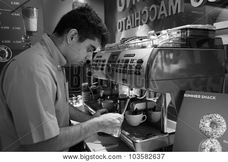 GENEVA - SEP 11: barmen prepare coffee on September 11, 2014 in Geneva, Switzerland. Geneva is the second most populous city in Switzerland and is the most populous city of Romandy