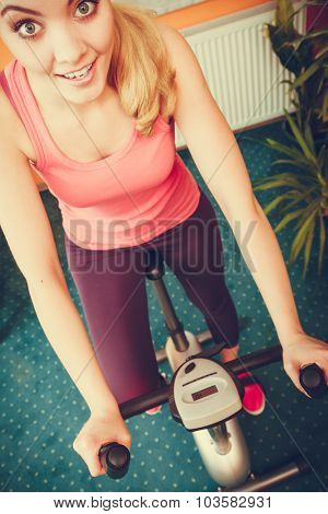 Woman Working Out On Exercise Bike. Fitness.