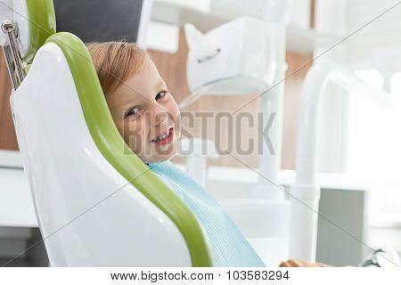 Pretty male child came to visit dentist