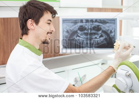 Attractive male dental doctor is making fun in lab