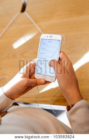 Woman checking email on smartphone
