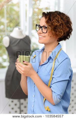 Nice designer drinking tea