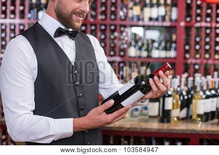 Attractive male waiter is working in liquor store