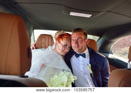 Young couple bride and groom celebrate wedding on Santorini