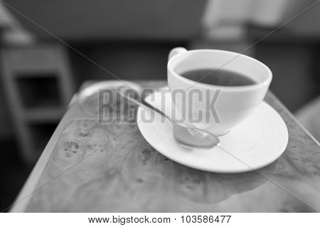 Cup of hot black tea served in business class
