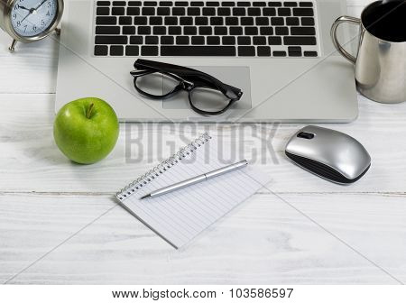 Close Up Of A Tidy Work Space On A White Desktop