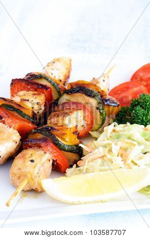 Barbeque chicken and vegetable skewers with side salad makes a light healthy summer lunch