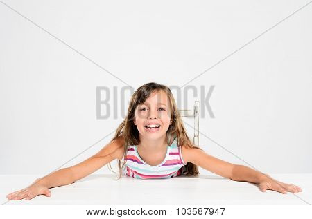 Cute adorable young girl poses for portrait in studio, isolated on grey