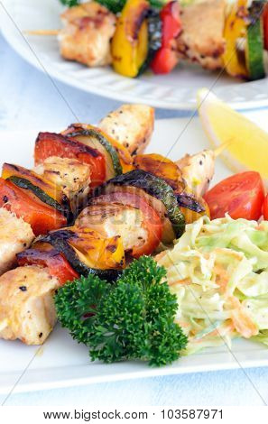 Barbecue chicken and vegetable skewers with side salad makes a light healthy summer lunch