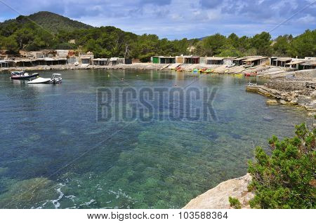 a view of the Sa Caleta cove in Ibiza Island, Spain, with its traditional fishermen shelters