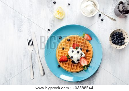 Breakfast waffles with blueberries and strawberries