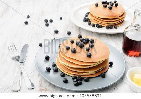 Blueberry pancake stacks with butter and maple syrup