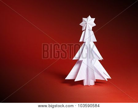 Christmas trees made of paper on red background. Christmas card