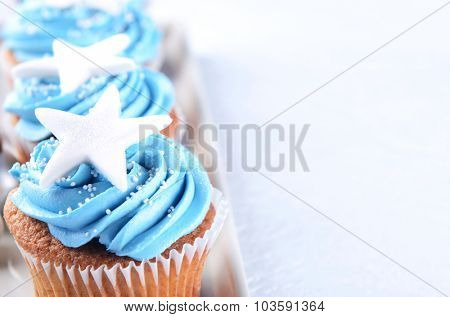 Vanilla cupcakes with blue frosting and a big star, christmas birthday party