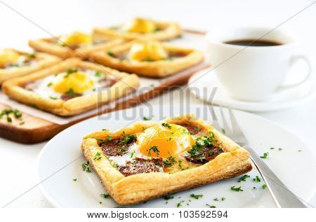 Single serving of savoury egg and chorizo pastry with more in the background