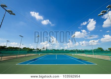 Outdoor Empty Tennis Court With Blue Sky