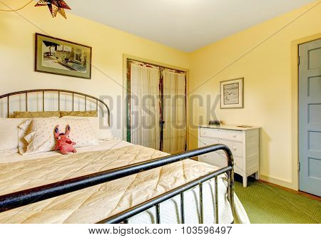 Colorful And Cozy Girls Bedroom With An Orange Wall.