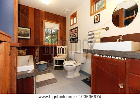 Unique Vintage Style Bathroom With Tile Floor.