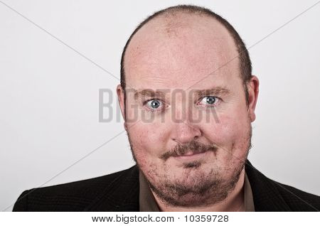 Close Up Portrait Of Middle Age Male On Off White Backdrop