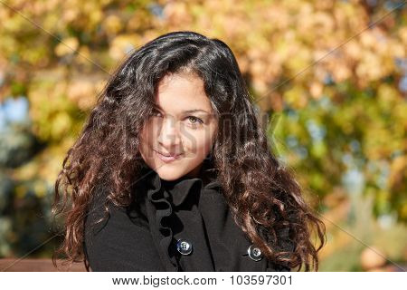 woman portrait in city park in autumn season