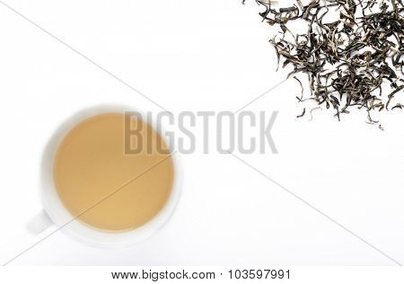 Green tea and leaves shot overhead with plenty of copy space