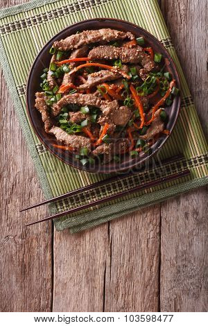 Asian Bulgogi Beef Slices Fried With Sesame On A Plate. Vertical Top View