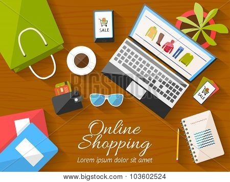 Online shopping concept desktop with computer, wooden table, shopping bag, mobile phone, notebook, f