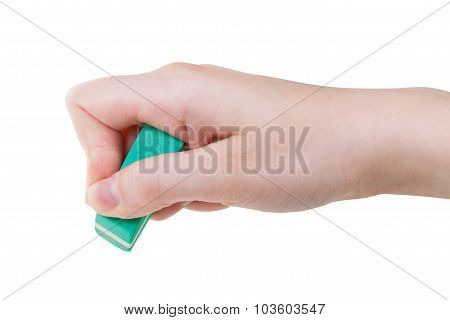 Hand With Green Rubber Eraser Close Up Isolated