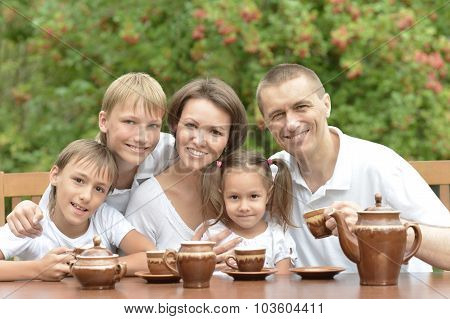 Family eating fruits in summer
