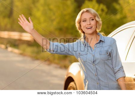 Attractive girl standing near car