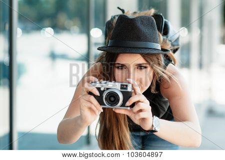 Tourist Photographs With Mirrorless Digital Camera.